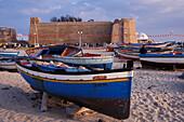 Boats on the beach, Kasbah Citadel, Cap Bon peninsula, Hammamet, Tunisia, North Africa, Africa