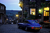 Jaguar E-Type in front of a pub in the evening, Haworth, Yorkshire, England, Great Britain, Europe