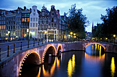 Magere Brug, Magere Bridge in the evening, drawbridge, Amstel river, Amsterdam, Netherlands