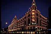The illuminated department store Harrods at night, London, England, Great Britain, Europe