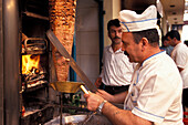 One Kebab cook cutting meat, Old Town, Antalya, Turkey