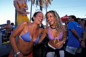 Two young girls having fun in the Bora-Bora Beach Disco, Platja d´en Bossa, Ibiza, Spain