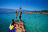 People on the wooden footbridge, Cleopatra Beach, Marmaris, Aegean sea, Turkey