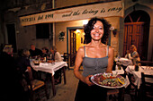 Woman with seafood, Capoliveri, Elba, National Park of the Tuscan Archipelago, Tuscany, Italy