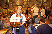 Waitress Barbara serving beer in the tent, Munich Oktoberfest, Bavaria, Germany