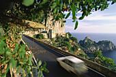 Car driving on the coastal road 163, Amalfitana near Positano, Campagne, Italy