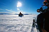 Person driving a snowmobil on Bruarjoekull, a strip of land at Vatnajoekull, Island
