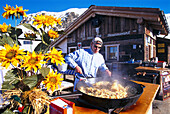 Cook frying Roesti, Jatz hut, Jakobshorn, Davos, Switzerland
