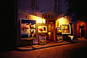 Pictures in front of a gallery in the evening, St. Tropez, Cote d´Azur, Provence, France, Europe