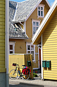 Bike resting against a fence, Cycle tour of Egersund, Rogaland, Norway