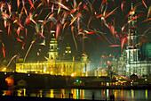 New years eve fireworks over Dresden, Buehlsche Terasse, Ständehaus, Hofkirche, Saxony, Germany