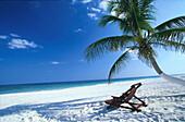 Palm beach with sun lounger, Carribean coast south of Tulum, Quintana Roo, Yucatán Peninsula, Mexico