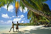 Two local people on the beach, Ile aux Nattes near Ile Sainte-Marie, East coast of Madagascar, Indian Ocean