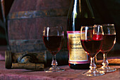 Bottle of Beaujolais primeur with three glasses, Beaujolais, Red wine, France