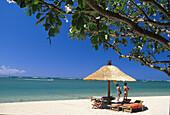 Beach with sunshade and sun loungers, Sanur beach, Bali, Indonesia, Indian ocean