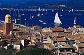 Sunlit roofs and sailing boats at Golfe de St.Tropez, St. Tropez, Cote d´Azur, Provence, France, Europe