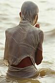 Praying pilgrim, Ganges river, Varanasi, Benares, Uttar Pradesh, India
