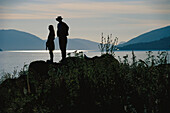 Silhouette of a couple admiring the view, Horse Riding, Norway