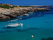 Boat in a bay, Cala de Binisafúller, Minorca, Balearic Islands, Spain