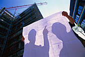 Two construction workers holding plan, building Site Biotechnology Martinsried, Bavaria, Germany