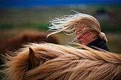 Young woman with Island pony, Midfjord, North, Iceland