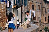 Tourists taking photo, Pienza, Tuscany, Italy