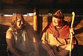 Two men, vikings, in Storholmen Viking Village, Viking Museum, Storholmen, Stockholm Archipelago, Sweden