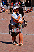 Hugging couple at Piazza del Campo, Siena, Tuscany, Italy