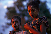 Girls with ornamental painting, Nosy Be, Madagascar