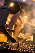 Man barbecuing sausages on a grill, Bavaria, Germany