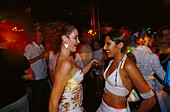Two girls dancing in Tito' s Palace, Discotheque, Palma, Mallorca Spain
