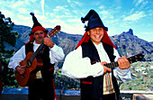 Two musicians in traditional clothes laughing, Folklore music, Celebration of the almond flower, Canary Islands, Spain