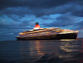 Cruise ship Queen Elizabeth 2 at night blurred motion, , North Sea , Germany