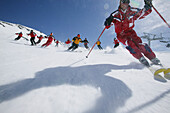 Group of skiers on the slope, Skiing downhill, Sulden, Italy