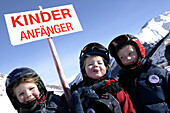 Skiing Galtueer, Austria, Three kids with sign, Beginner, Wirl near Galtuer, Tyrol, Austria
