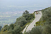 People on a cycle tour starting downhill from puig randa, Majorca, Balearic Islands, Spain