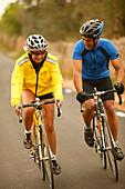 Couple cycling on racing bikes, Majorca, Balearic Islands, Spain