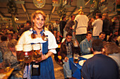 Waitress Barbara serving beer in the tent, Munich, Oktoberfest, Bavaria, Germany