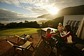 Family eating outdoors, Wilderness, Garden Route, Western Cape, South Africa