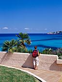 Female hiker admiring the view, Cala Mesquida, Majorca, Spain