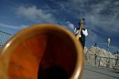 Swiss horn blower on summit, Zugspitze, Bavaria, Germany