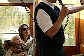 Tourist guide on excursion boat, Tourist guide on excursion boat, St.Bartholomae, Koenigssee, Berchtesgaden, Bavaria, Fremdenfuehrer, Ausflugsboot bei St.Bartholomae, Koenigssee, Berchtesgaden, Bayern, Deutschland