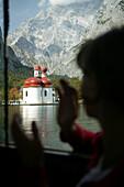 Tourists in excursion boat, Tourists on excursion boat, St.Bartholomae, Koenigssee, Berchtesgaden, Bavaria, Touristen in Ausflugsboot bei St.Bartholomae, Koenigssee, Berchtesgaden, Bayern, Deutschland
