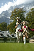 Mother with children on meadow, Mother with children on meadow, St.Bartholomae, Koenigssee, Berchtesgaden, Bavaria