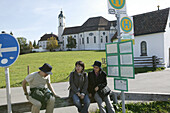 Japanese tourists at the bus stop near Wieskirche, Steingaden, Bavaria, Germany