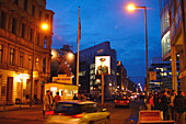 Street setting with cars and pedestrians in the evening, Checkpoint Charlie, Berlin, Germany, Europe