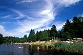 People bathing in Eizenberg Pond, Fuenfseenland, Bavaria, Germany