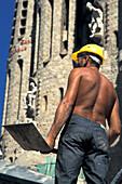 Worker in front of Sagrada Familia, Barcelona, Spain, Europe