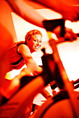 Spinning, Young woman in gym on exercise bikes, Spinning, leos Sports Club Muenchen