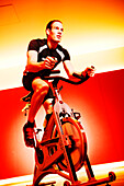 Spinning, Young man in gym on exercise bikes, Spinning, leos Sports Club Muenchen